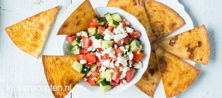 Tortilla chips met komkommersalade