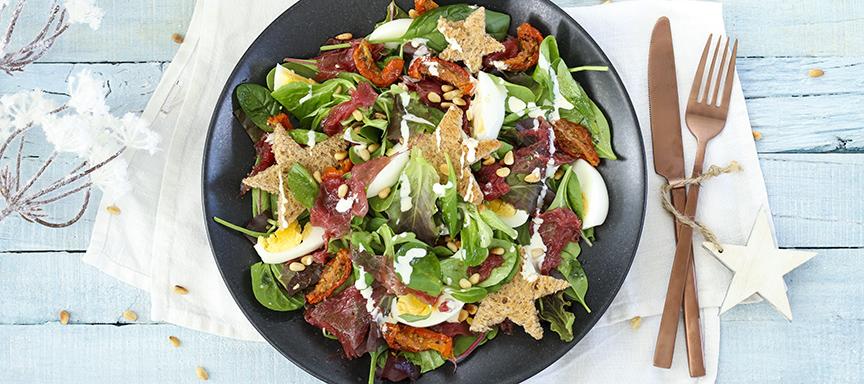 Salade met carpaccio en truffeldressing